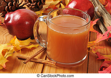 Hot apple cider - A cup of hot apple cider on an autumn...