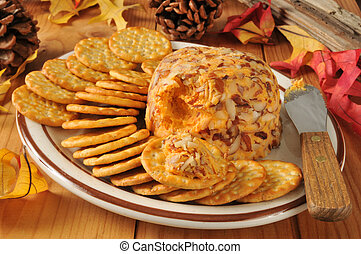 Cheddar cheese ball with crackers - A cheddar cheeseball...