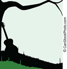 Guitar and Tree - Silhouette of a branch stretching out over...