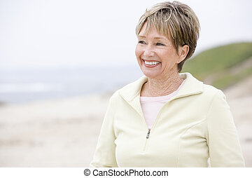 Woman at the beach smiling