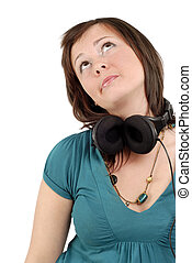 Woman wearing headphones - Caucasian woman listening to...