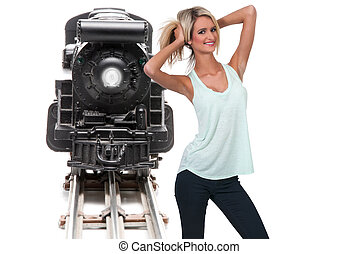 Miniature Train - Woman with a replica of a steam powered...