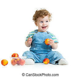 baby boy eating fruits isolated on white background