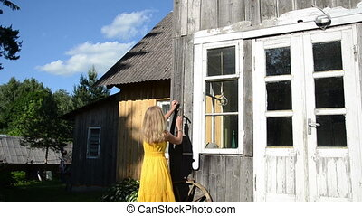 woman hang horse shoe - Woman in yellow dress hang horse...