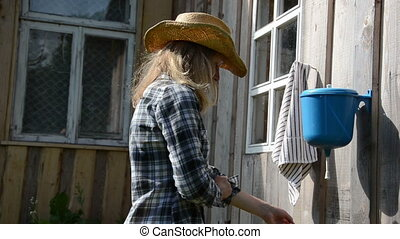farmer woman wash hand - farmer cowgirl woman wash hands...