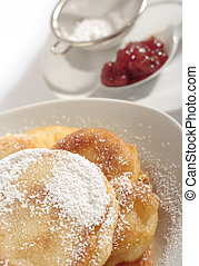 Polish doughnuts poured with icing sugar