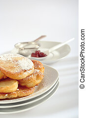 Polish doughnuts poured with icing sugar - The close-up view...
