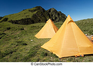Tents In Alpine - Two yellow tents just standing on...