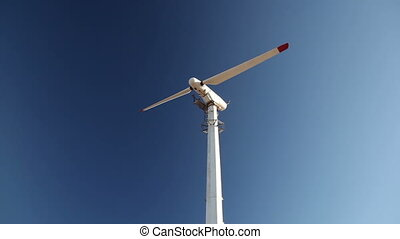 Rotating windmill blades in sky - Rotating windmill blades...