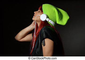 beautiful woman listening music - beautiful young woman with...