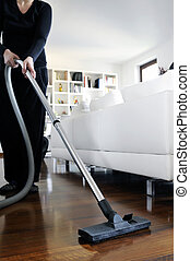 vacuum cleaner - woman who cleans the floor of the house