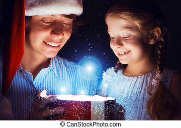 father and daughter opened a box with a gift - father in...