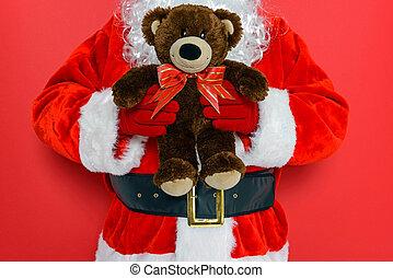 Santa holding a teddy bear
