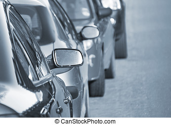 Parked cars in street - Line of parked cars in city street...