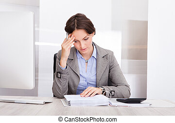 Thoughtful Businesswoman Doing Calculations - Portrait Of A...