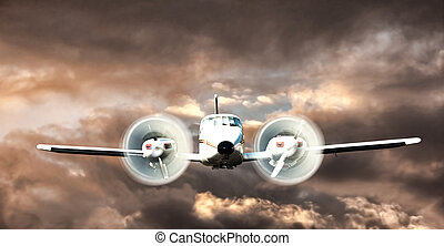 plane flying - cessna axtec flying through the clouds...