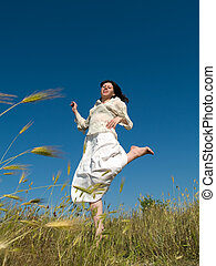 Happy Young Lady Runs Through Field - Happy Young lady Runs...