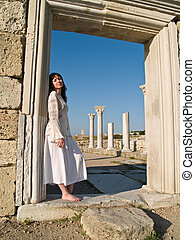 Barefoot Girl Leaning Ancient Ruins - Beautiful barefoot...