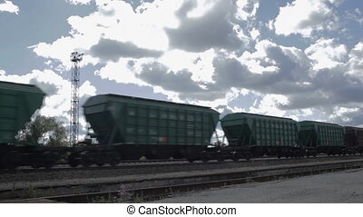 The freight train is passing by on a sunny day in Estonia
