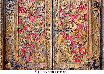 Indian inspired carved golden red wooden door