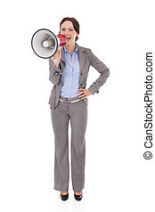 Businesswoman Shouting Through Megaphone - Young...