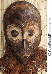 African wood mask used by sorcerers and shamans during...