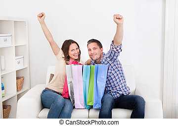 Excited Couple With Shopping Bag - Excited Young Couple...
