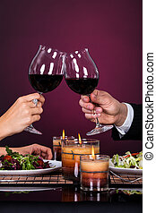 Couple Tossing Wine Glass - Smiling Couple Tossing Wine...