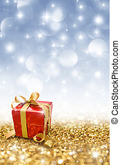 red gift on golden glitter  - red gift on golden glitter