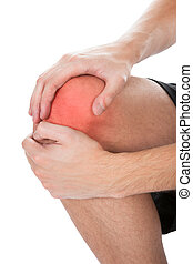 Man Having Knee Injury - Close-up Of Man Suffering From Knee...