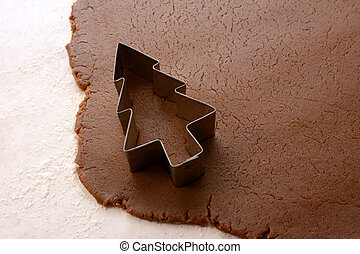 Cutting out a Christmas tree from gingerbread