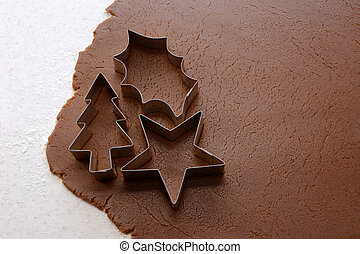 Cutting out Christmas shapes from gingerbread dough