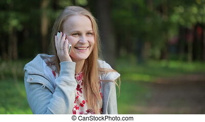 Woman chatting on her mobile phone outdoors