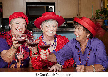 Three red hat ladies toasting with wine - Three red hat...