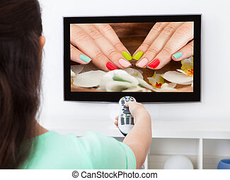 Woman Changing Television Channel - Close-up Of A Woman...