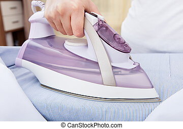 Person Ironing Clothes - Close-up Of Woman's Hand Ironing...