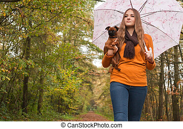 Fashion girl with a dog in the forest - Young teenage girl...