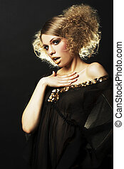 fashion model with curly hair in black tunic