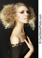 fashion model with curly hair in black tunic in black...