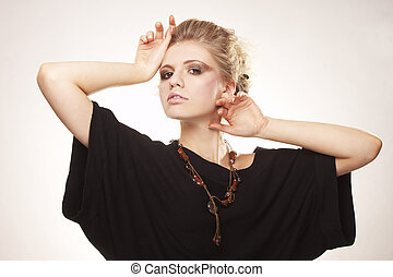 Fashion model with strong makeup posing on white background