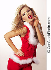 Portrait of beautiful sexy girl wearing santa claus clothes...