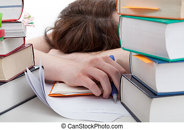 Exhausted student behind a books - Exhausted student lying...