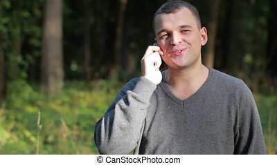 Man laughing as he chats on his mobile