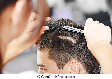 Hairdressing at beauty parlour - Hairdresser making haircut...