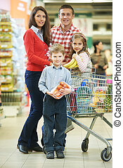 Family with children shopping fruits - woman with man and...