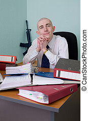 Self-satisfied worker of office armed with a rifle - The...