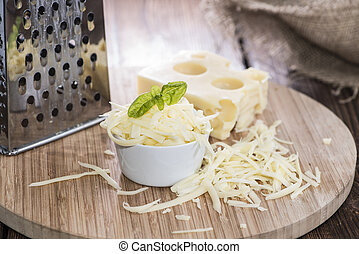 Emmentaler with Cheese Grater on wooden background