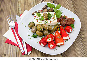 Fresh Antipasto on a plate against wood