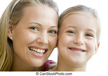 Woman and young girl smiling