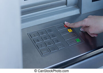 Woman selecting a transaction type on the bank ATM